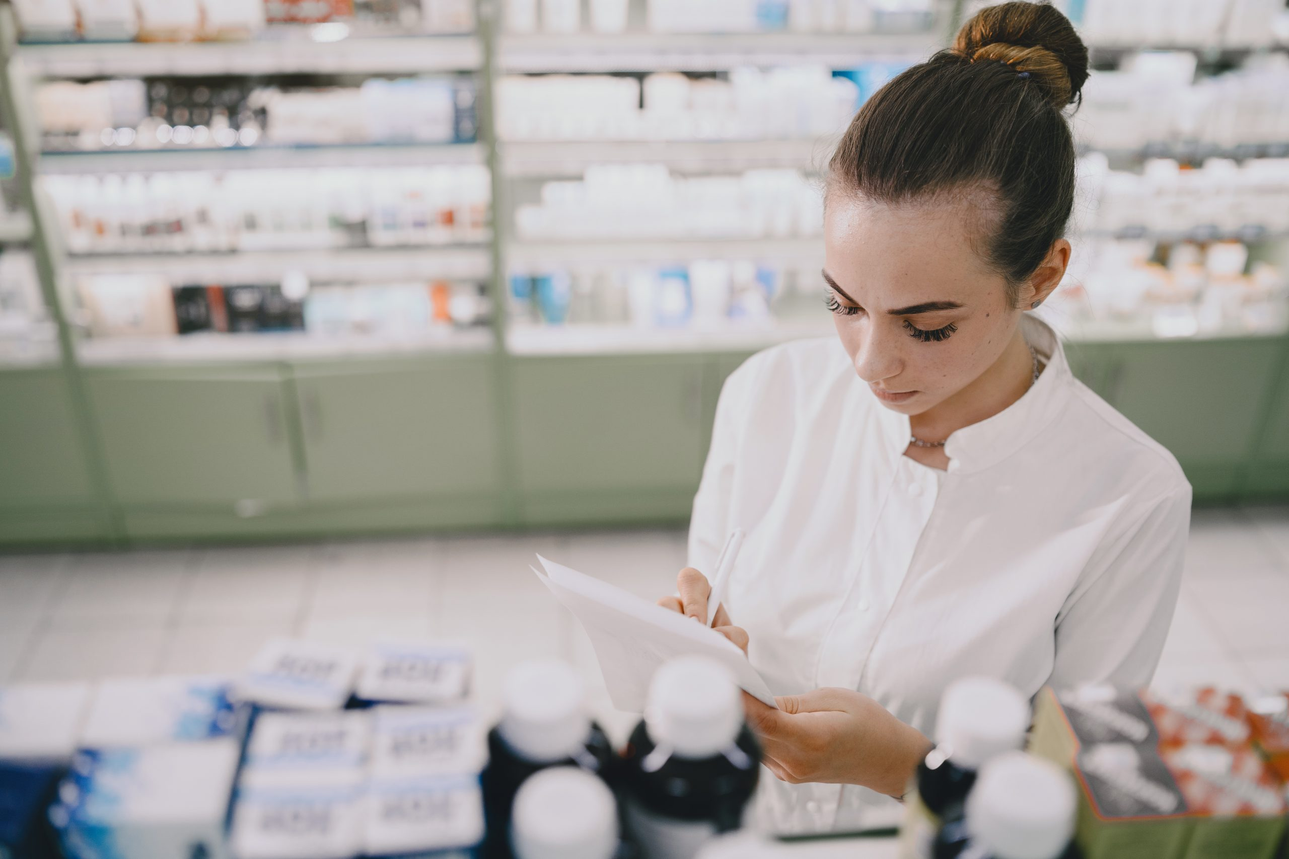Woman pharmacist checking medicine in pharmacy